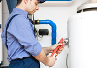 Employee-repairing-a-hot-water-heater